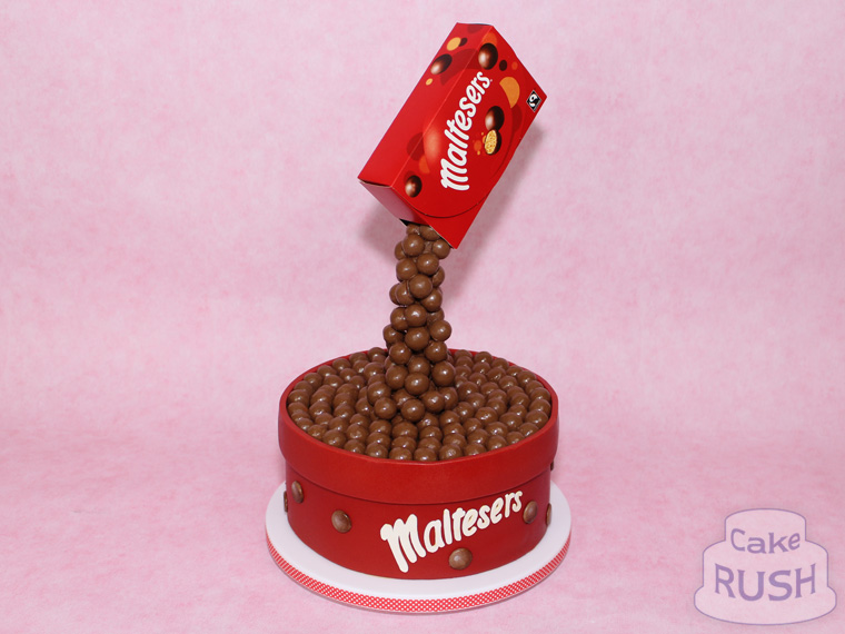 Pouring Maltesers cake